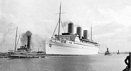 Empress of Britain towed out to sea